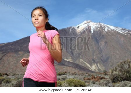 Woman Running On Mountain Trail