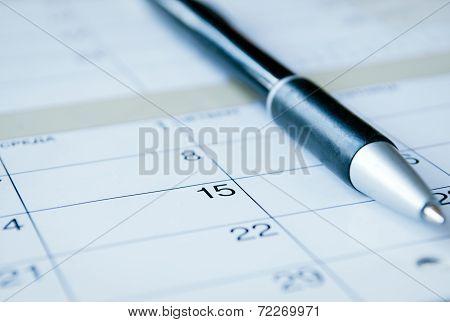 Ballpoint Pen On A Calendar