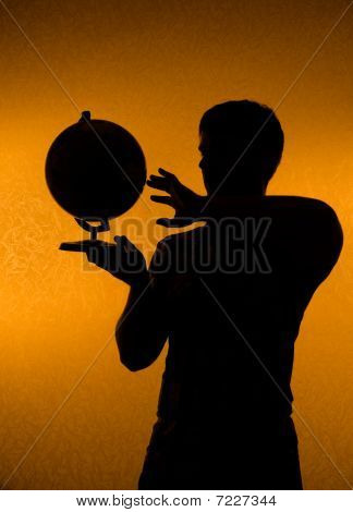 Discover The World - Silhouette Of Man Holding Globe