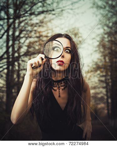 Strange Goth Girl Looks Through A Loupe