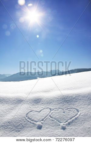 Wintry Bavarian Landscape With Love Hearts And Bright Sunshine With Flares