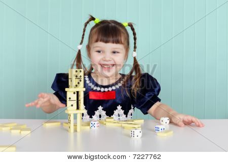 Little Happy Girl Is Playing With Toys