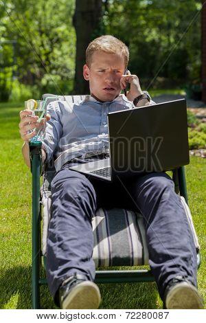 Businessman Talking On Phone In Garden