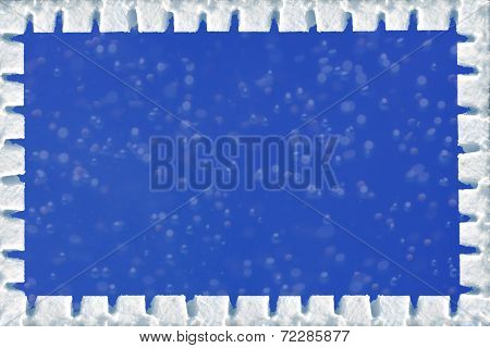 Winter Frame With Powder Snow Border And Blue Background With Blurred Snow Flakes