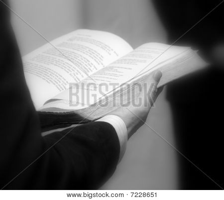 Priest Holding A Bible.