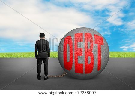 Business Man Being Trapped With Debt Ball
