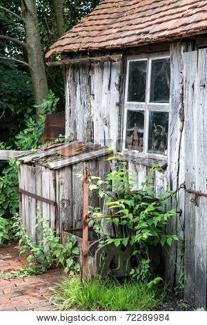 Ancient Medieval Ironmonger Shed In Forest Landscape Setting