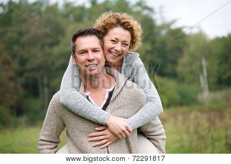 Smiling Couple Having Fun With Piggyback Ride