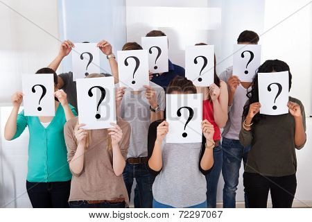 University Students Holding Question Mark Signs