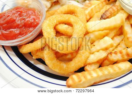 Serving Of Onion Rings And French Fries