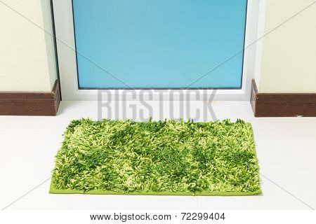 Green Cleaning Feet Doormat Or Carpet In Front Of Toilet Door