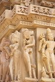 stock photo of kandariya mahadeva temple  - Apsara naked ladies sculpture on Kandariya Mahadeva Temple at Khajuraho in India Asia - JPG