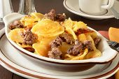 foto of scallops  - A hamburger and scalloped potato casserole in cheddar cheese sauce - JPG
