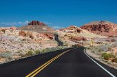 foto of valley fire  - The road going through the varicolored rocks of Valley of Fire State Park located near Las Vegas USA - JPG