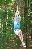 picture of ropeway  - Man sliding on ropeway at high rope course - JPG