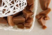 image of toffee  - Old fashioned English hard toffee pieces in a basket - JPG