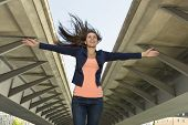 stock photo of self-confident  - Happy self confident woman in urban environment Outdoor Shot - JPG
