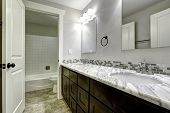 stock photo of granite  - Bathroom vanity cabinet with white granite top and mirrors - JPG