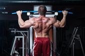 image of light weight  - Male Bodybuilder Doing Heavy Weight Exercise For Back - JPG