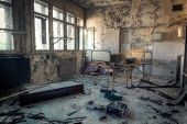 image of dingy  - Interior of an abandoned building with rubble and debris - JPG