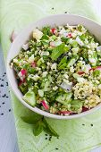 foto of tabouleh  - Tabouleh style salad made with millet and vegetables