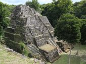 stock photo of significant  - Ruins of the Mayan city of Yaxha in Guatemala - JPG