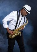 foto of saxophone player  - Saxophonist black men in white shirt - JPG