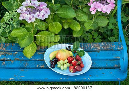 Fresh Fruits On Plates Placed On Top Of The Bench