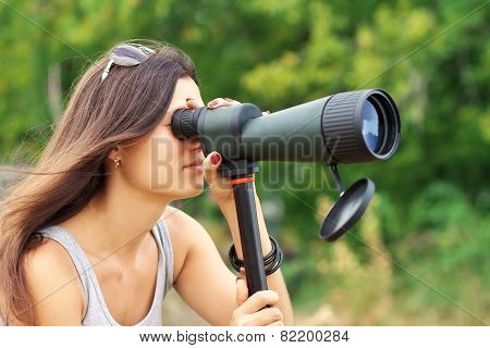 Positive Girl Who Is Watching In Spotting Scope.