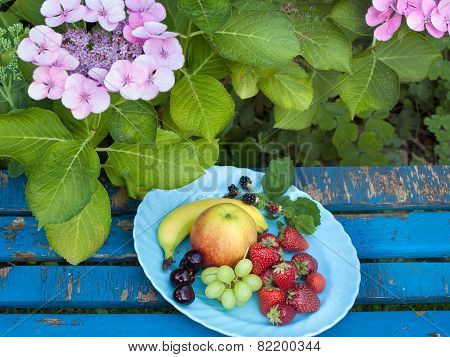 Aerial Shot Of Fresh Fruits On Plate At The Garden