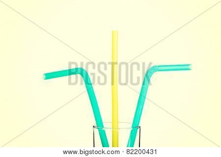 Group of colorful straws in vertical view.