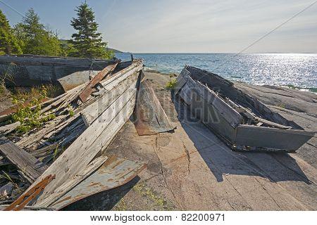 Abandoned Boats On A Remote Lake Shore