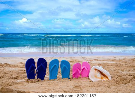 Color Flip Flops Next To Ocean