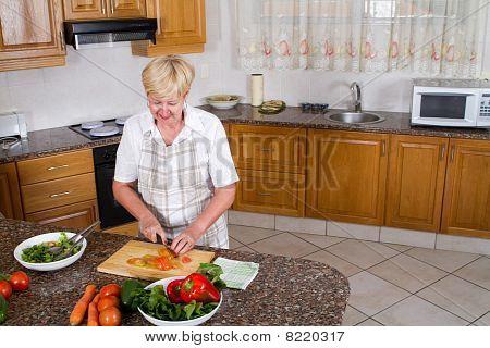 senior woman making salad