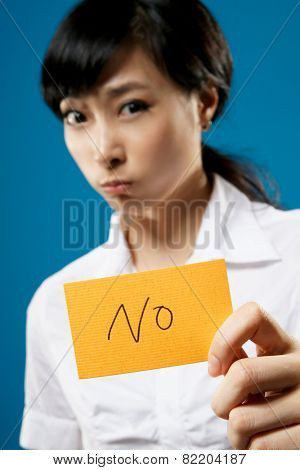 Asian business woman holding yellow card with