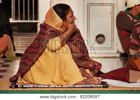 Woman In Beige Saree In Golden Temple. Amritsar. India
