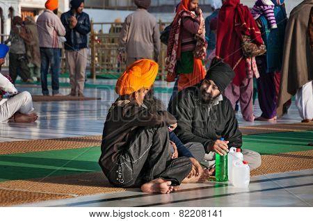Sikh Man Praying In Golden Temple. Amritsar. India