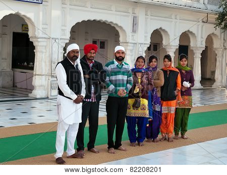 Group Of Indian People In Golden Temple. Amritsar. India