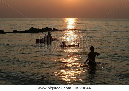 sunset on kids playing in water
