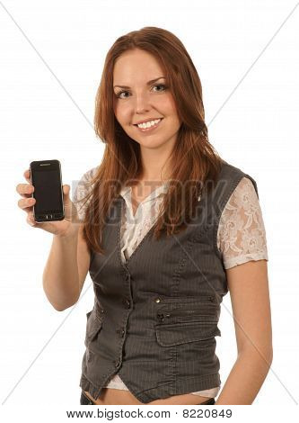 Smiling young woman holds mobile phone