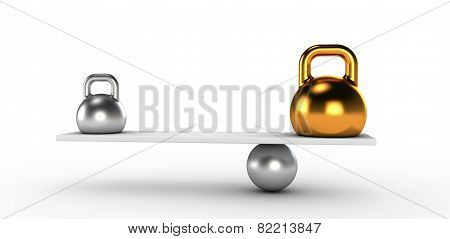 Two gold and silver kettlebells  in equilibrium