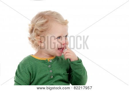 Adorable blonde baby looking at side isolated on a white background