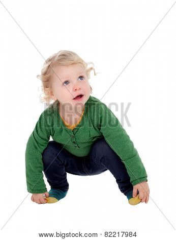 Adorable blond baby isolated on a white background