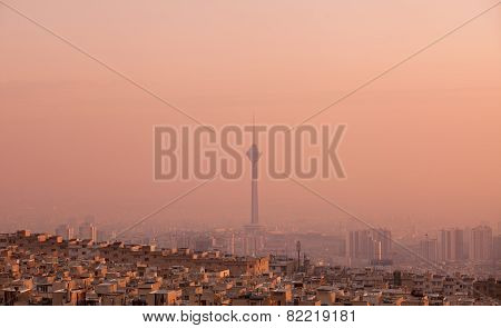 Milad Tower In The Skyline Of Tehran At Pink Sunset