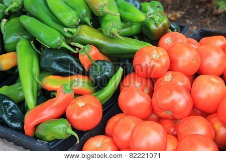 Tomatoes And Hot Peppers For Sale At A Farmers Market