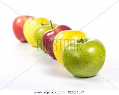 multicolored apples arranged in line