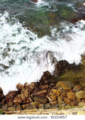 Waves hit the rocky beach Galle Fort
