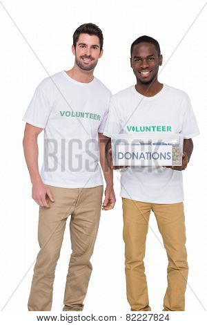 Portrait of smiling men participating at charity on white background