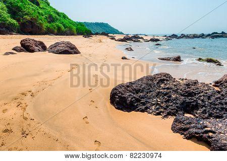 Human Footprints On A Sandy Beach On The Island