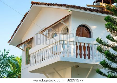 White House With A Balcony In A Tropical Climate
